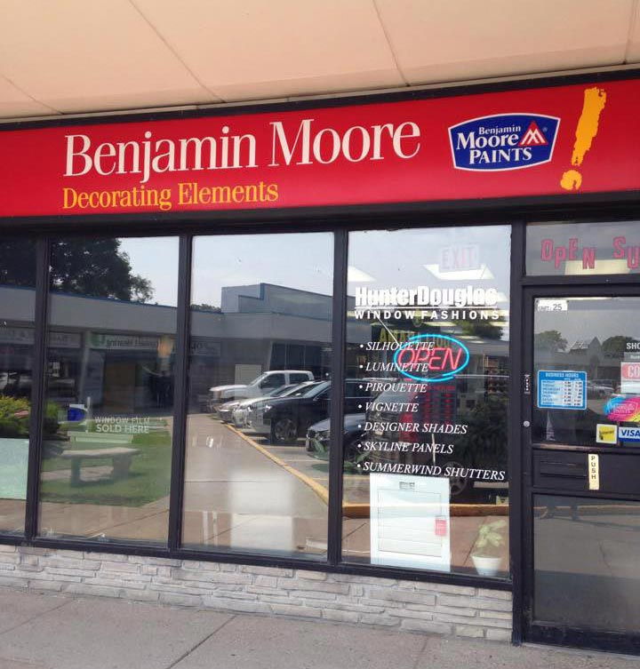 A Benjamin Moore Decorating Elements store front with open neon sign