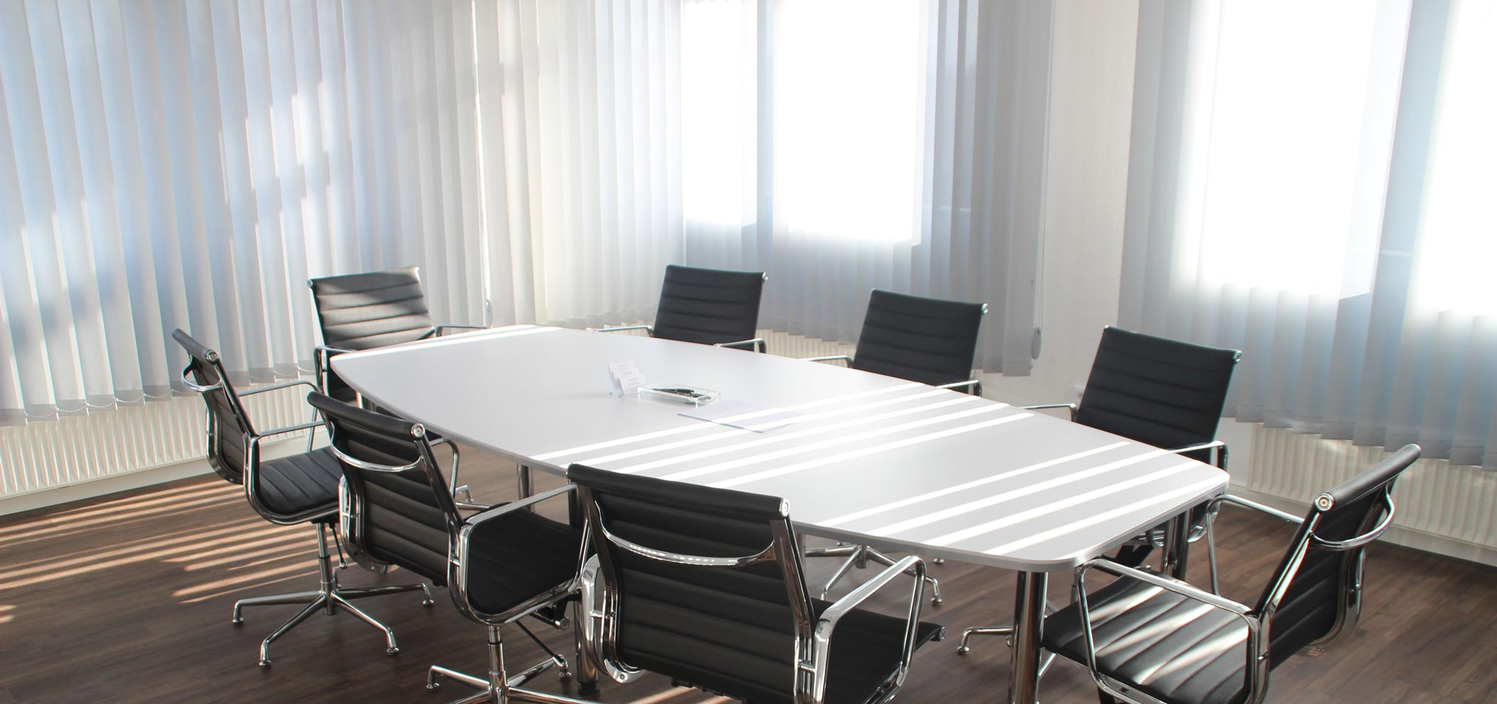 Light shine through the white vertical shades to modern simple office conference room
