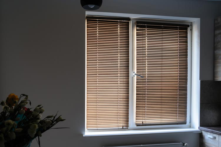 A modern interior with woven wood shades covering the window
